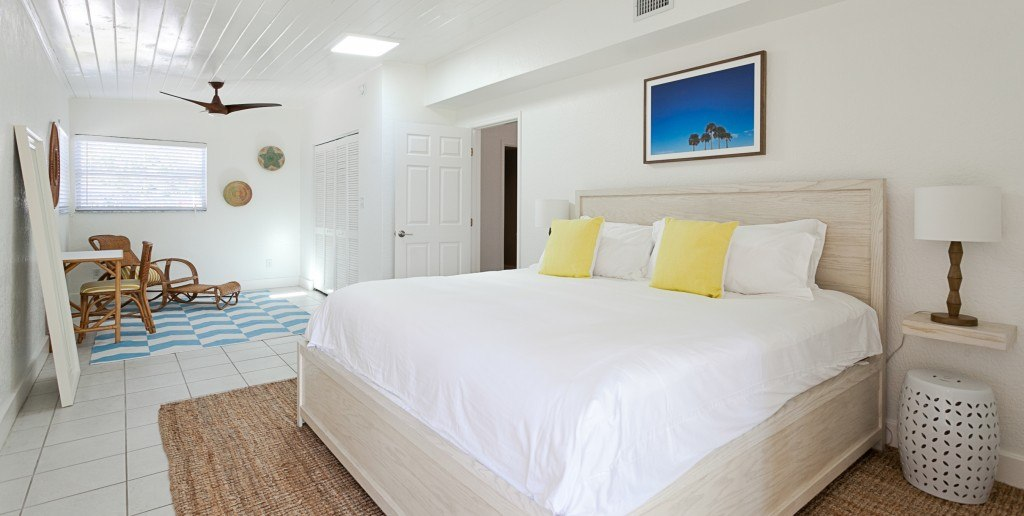 white king bed with sisal rug