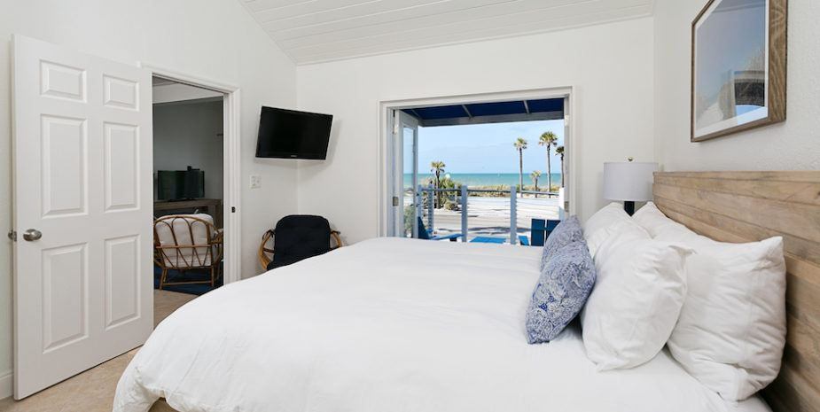 room with beautiful beach view and flat screen TV